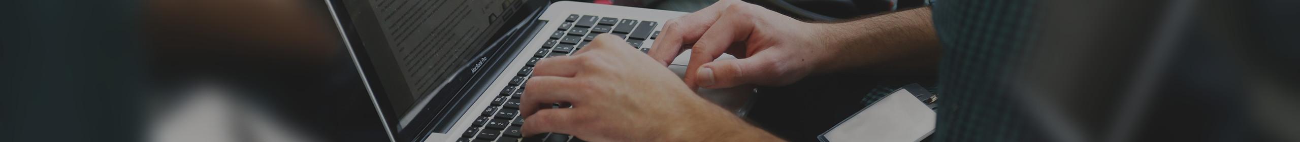 laptop sitting on knees writing a blog